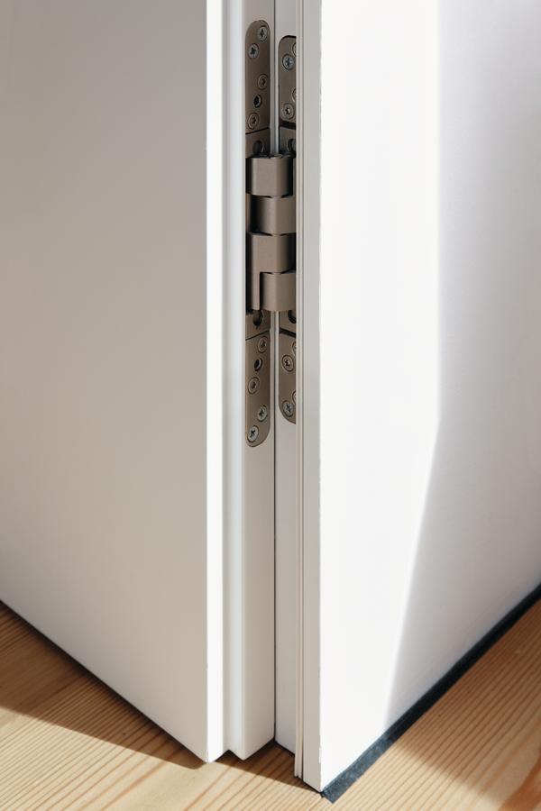 auf die fl chenb ndige t r folgt die unsichtbare zarge fr her hie das tapetent r. Black Bedroom Furniture Sets. Home Design Ideas