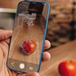 Men_using_artificial_intelligence_on_smart_phone_with_augmented_reality_application_for_recognizing_food