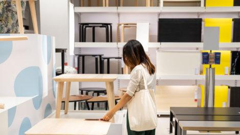 Young_woman_choosing_furniture_in_a_modern_home_furnishings_store
