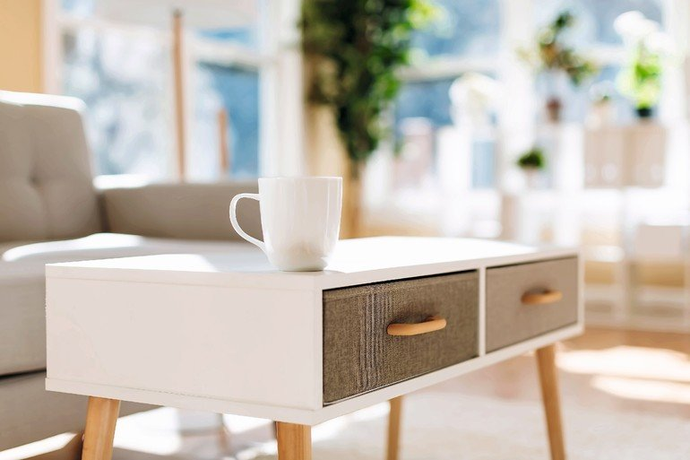 Luxury_interior_home_with_coffee_cup_and_gray_midcentury_loveseat