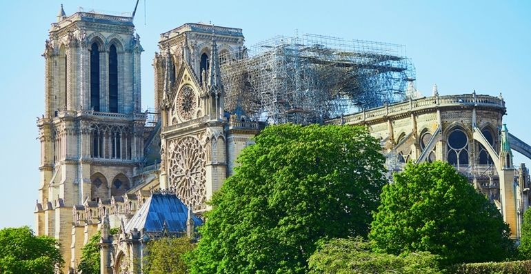 View_of_Notre_Dame_cathedral_without_roof_and_spire_destroyed_by_fire_in_Paris,_France