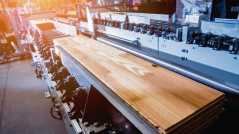 Production_line_of_the_wooden_floor_factory._CNC_automatic_woodworking_machine._Industrial_background_Production_line_of_the_wooden_floor_factory._CNC_automatic_woodworking_machine._Industrial_background