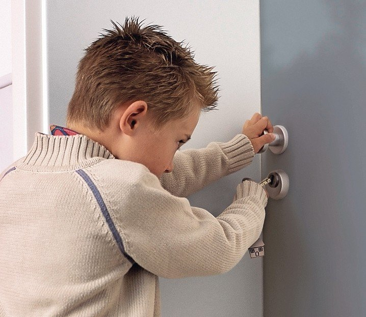 Boy_unlocking_door